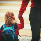 Mother walking daughter to school. Picture: Getty Images/iStockphoto
