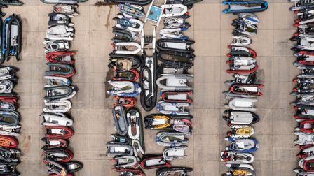 Inflatable dinghies used by migrants to cross the channel from France are stored in a compound in Dover, England