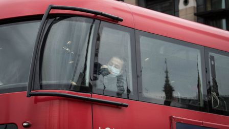 Passengers wear protective masks on buses in London, bus passengers in London will not have to pay t