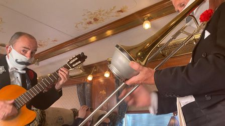 Musicians play on board the Northern Belle while guests enjoy their dinner.
