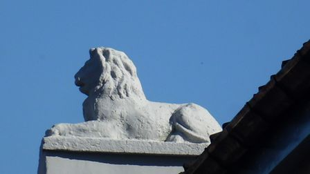The lion statue on top of the former Lion Inn on Cattle Market Street in Norwich.