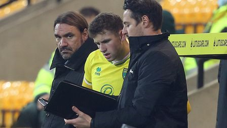 Norwich Assistant Head Coach Eddie Riemer gives instructions to Reece McAlear of Norwich as he prep