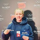 Charley Davison with her ticket to the Tokyo Olympics.