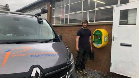 Positive Sparks' Stuart Robb fitting the defib free of charge
