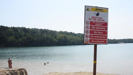 A sign at Bawsey Country Park warns people to stay out of the water.