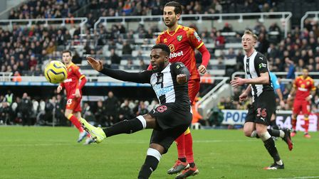 Danny Rose of Newcastle United clears the ball ahead of Mario Vrancic of Norwich during the Premier