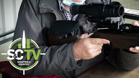 a man with an Air Arms S510R Ultimate Sporter air rifle