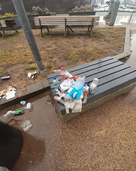 Bottles and cans were among the items left on the benches