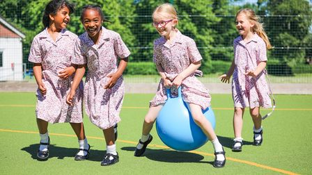 Students playing outside at Cumnor House School for girls in Surrey, England.