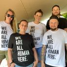 Members of the team at The Victoria pub onIckleford Rd sporting Humanitas' 'We Are All Human Here' T-shirts