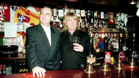 Francis Rossi (Left) and Rick Parfitt (Right) behind the bar at the Railway pub in 1999