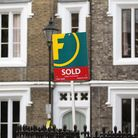 For Sale signs displayed outside houses in Islington, North London.
