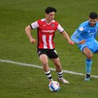 Exeter City's Joel Randall (left) and Cheltenham Town's Conor Thomas during the Sky Bet League Two m