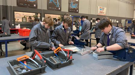 Students learning engineering skills as part of their studies at UTCN in Norwich.