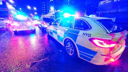Police cars parked with flashing lights.