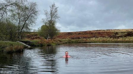 Peter swimming in the open water in the Derbyshire Moors