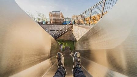 A seven metre rooftop slide that leads from the main roof terrace of the Robinson building in Wembley Park