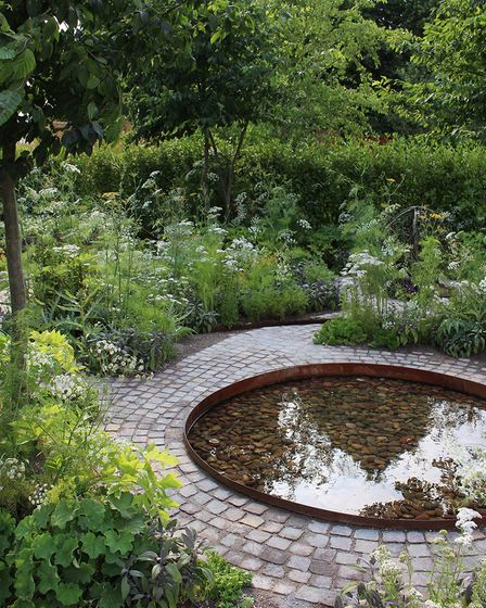A wellbeing garden design with a water feature.