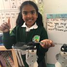 Senara Gunawardene with the braces and bar which have helped correct her club feet