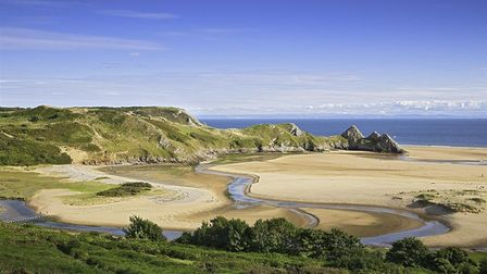 Three Cliffs Bay is the perfect Blue Flag certified beach to visit on a UK staycation in the Mumbles and Gower area in Wales.