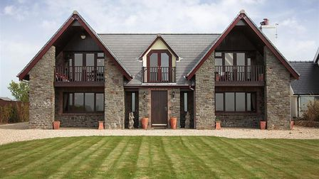 Driftwood House, a gorgeous property overlooking Hunt Bay in Gower, South Wales