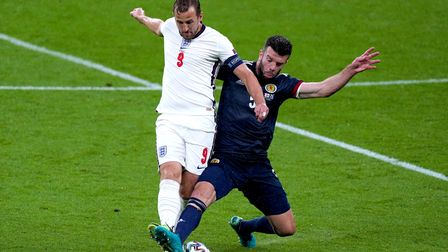 England's Harry Kane (left) and Scotland's Grant Hanley battle for the ball during the UEFA Euro 202