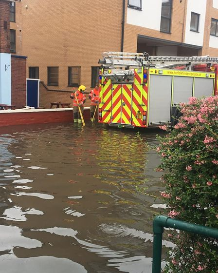 Fire crew pump water away from the The Dock Tavern in Gorleston