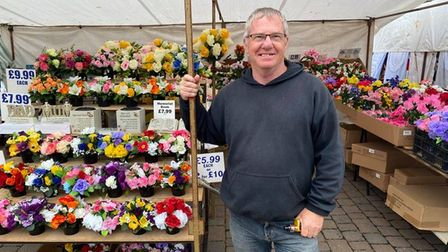 Paul Proto runs an artificial flower stall at Great Yarmouth's two-day market.