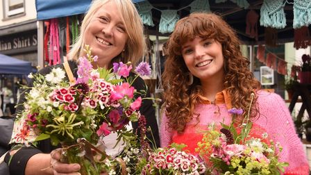 Lucy Spencer, left, of Hall Lane Flowers, showing her colourful blooms with Amelia Collis,