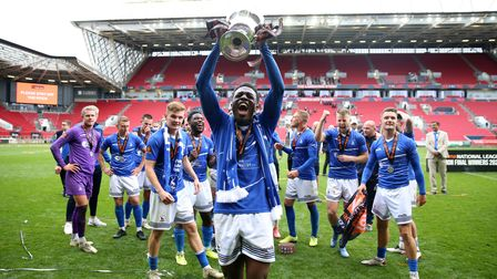 Hartlepool United's Timi Odusina celebrates with the trophy after winning the shoot-out and promotio