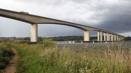 Police are with a person in distress on the Orwell Bridge.