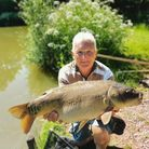 Bob Wooster with a mirror Carp from Newbarn