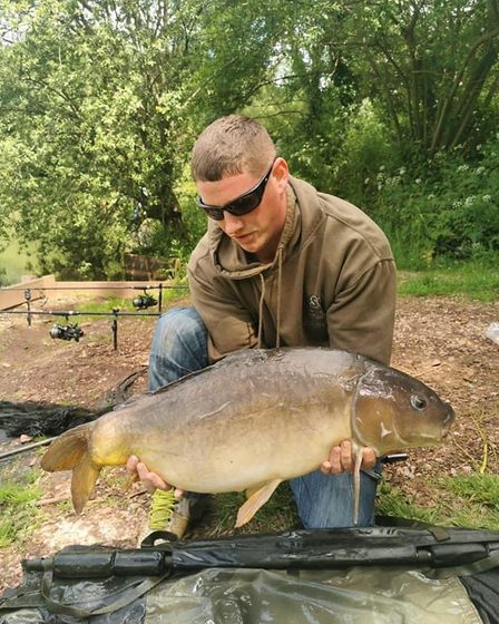 Steve Oliver with a leather Carp from Newbarn Angling Centre