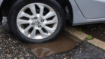 The deep pothole on the footpath at the entrance to the Beechcroft Surgery at Costessey. Picture: D