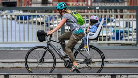 A woman and youngster cycle across a bridge in Bristol as the Government launches a strategy to get