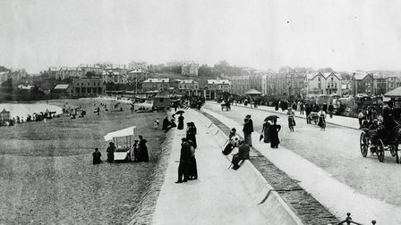A view of Paignton beach with bathing machines, bicycles and horse drawn vehicles from the Tully Col