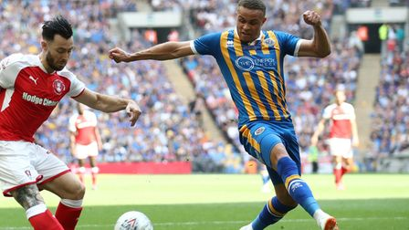 Carlton Morris suffered a serious knee injury in the League One play-off final on loan at Shrewsbury