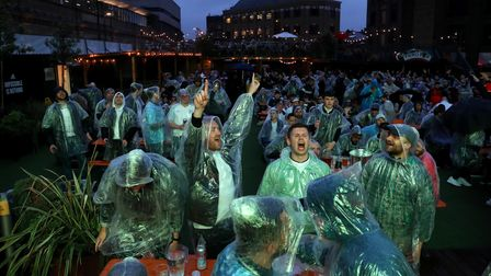 Fans watch the England v Scotland UEFA Euro 2020 match at Vinegar Yard, London. Picture date: Friday