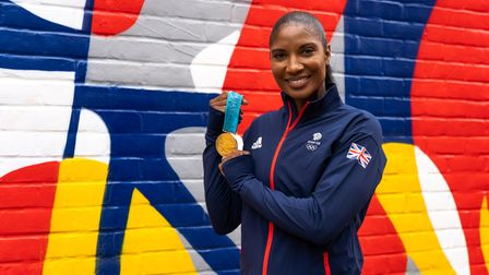 Denise Lewis in front of the mural in St Albans.