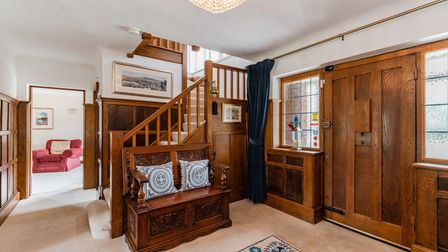 The oak panelled entrance hall is packed with character.
