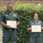 Keith Plummer and Sukhjit Kadri with commendations