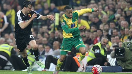 Martin Olsson of Norwich and Steven Berghuis of Watford in action during the Barclays Premier League