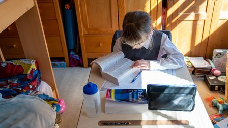 Emily, 9, sits at her desk at home on the first day of home schooling after schools shut on Friday d