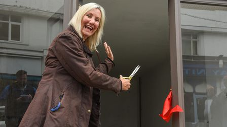 Caroline Dinenage MP cutting the ribbon at 160 King Street in Great Yarmouth, a building which has b