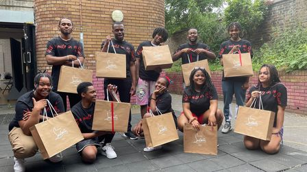 Young people from Immediate Theatre with gift bags.