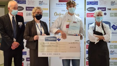 Stevenage budding chef Reece Bosowitz with a cheque for winning competition
