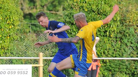 Action from the Coast and Country Division Three Cup final -Brixham Town (yellow) 3-1 Totnes and Dartington Reserves