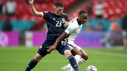 File photo dated 18-06-2021 of Scotland's Billy Gilmour (left) and England's Raheem Sterling during
