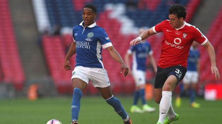 Macclesfield Town's Rhys Browne (left) and York City's Sean Newton in action