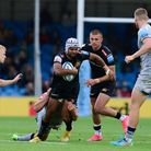 Tom OÕFlaherty of Exeter Chiefs is tackled by Manu Tuilagi of Sale Sharks during the Gallagher Premi